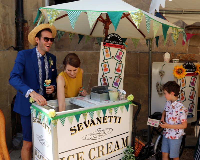 alt=serving ice cream from ice cream trike