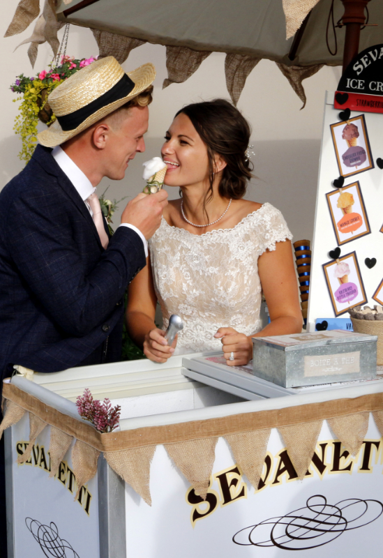 alt=bride and groom with ice cream bike